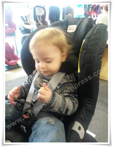 Britax Max Way is a rear facing car seat. Headrest is pulled to the top, making the straps go far above the child's shoulders.